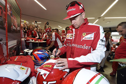 Kimi Raikkonen, Ferrari signs gloves for the fans
