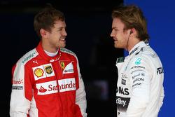 Terzo posto Sebastian Vettel, Ferrari SF15-T e il polesitte Nico Rosberg, Mercedes AMG F1 W06