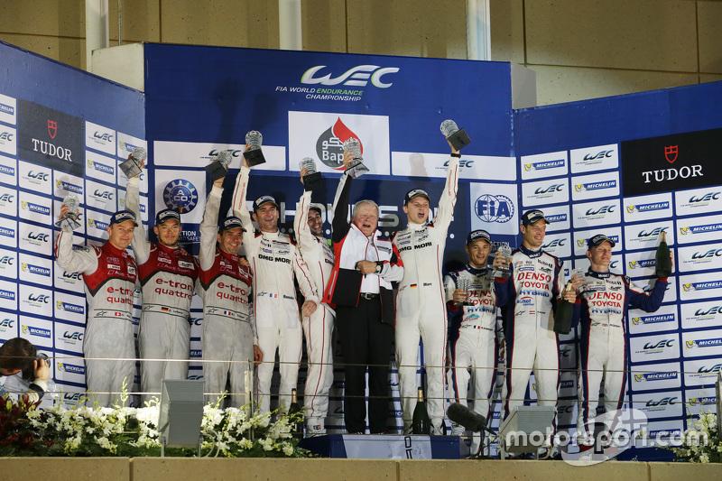 Podium: overall winners Romain Dumas, Neel Jani, Marc Lieb, Porsche Team, second place Marcel Fässler, Andre Lotterer, Benoit Tréluyer, Audi Sport Team Joest, third place Alexander Wurz, Stéphane Sarrazin, Mike Conway, Toyota Racing