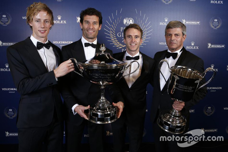 Porsche trio Brendon Hartley, Mark Webber and Timo Bernhard claim the spoils for their WEC success along with team boss Fritz Enzinger.