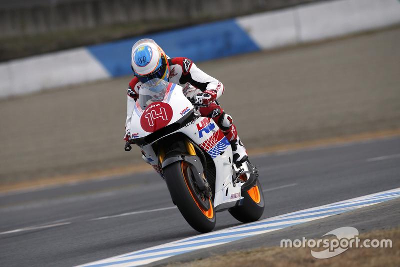 Fernando Alonso auf einem Honda-Motorrad