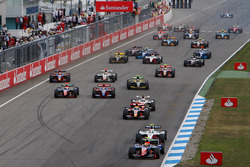 Giorgio Pantano leads the field into turn one on the opening lap of the race