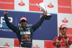 Karun Chandhok celebrates his victory on the podium with Bruno Senna