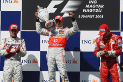 Podium: race winner Heikki Kovalainen, second place Timo Glock, third place Kimi Raikkonen