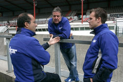 David Price, Team Principal talks with Leon Price, and a DPR engineer