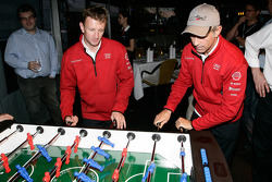 Allan McNish and Rinaldo Capello play fussball at the Audi Sport Team Joest hospitality