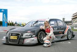 Maria de Villota poses with an Audi A4 DTM