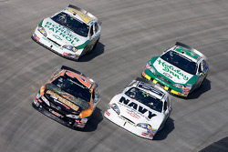 Joey Logano leads Brad Keselowski and Scott Wimmer