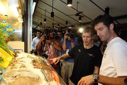 Sebastian Vettel and Mark Webber at the Newton Food Circus