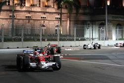 Timo Glock, Toyota F1 Team, TF108 leads Heikki Kovalainen, McLaren Mercedes, MP4-23