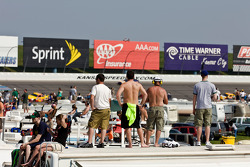 Fans try to catch a glimpse of their favorite drivers during the race