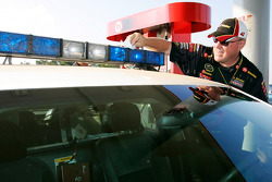 Havoline crew members service a patrol car at a Texaco station in Talladega