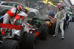 2008 World Champion Lewis Hamilton celebrates with Heikki Kovalainen and Jenson Button