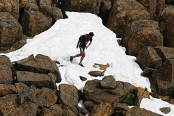 Launceston, Australia: Mark Webber treks through the snow on top of Cradle Mountain
