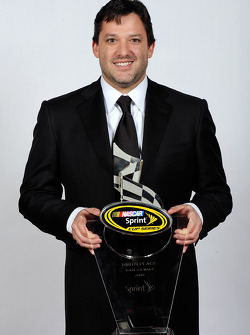 Tony Stewart poses with his award for ninth place in the NASCAR Sprint Cup Series Chase
