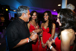 Dr Vijay Mallya Force India F1 Team Owner with the Fly Kingfisher Girls on the Fly Kingfisher boat party on the Indian Empress