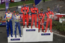 Podium: rally winners Sébastien Loeb and Daniel Elena, second place Daniel Sordo and Marc Marti, third place Mikko Hirvonen and Jarmo Lehtinen
