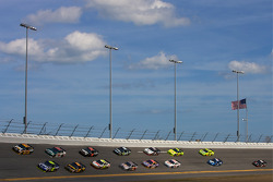 Jimmie Johnson, Hendrick Motorsports Chevrolet leads a group of cars in turn 4