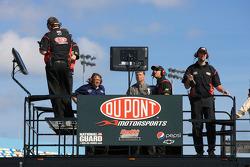 Hendrick Motorsports Chevrolet crew members watch practice from atop their hauler