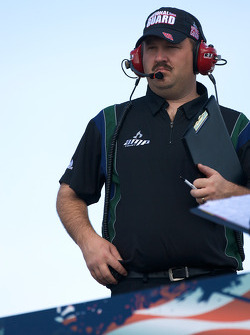 Tony Eury Jr., crew chief for Dale Earnhardt Jr., Hendrick Motorsports Chevrolet, watches practice from atop the hauler