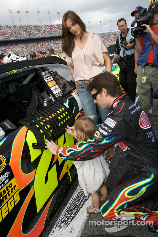 Jeff Gordon, Hendrick Motorsports Chevrolet, shows his car to his daughter Ella Sofia while his lovely wife Ingrid Vandebosch looks on