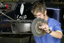 A Super Nova Racing mechanic at wok