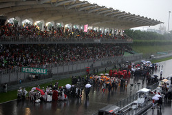 Race stopped due to rain and the cars form up on the grid