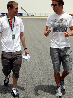 Sebastian Vettel, Red Bull Racing after his arrival on the track walk with his team gets overtaken by Jenson Button, Brawn GP on his walk