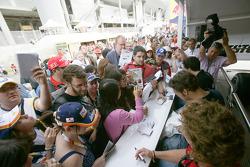 Dani Clos, Roldan Rodriguez and Alvaro Parente sign autographs