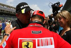 Michael Schumacher, pilote d'essais de la Scuderia Ferrari et Ross Brawn, directeur général de Brawn GP