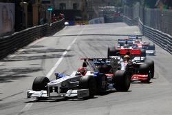 Robert Kubica, BMW Sauber F1 Team leads Lewis Hamilton, McLaren Mercedes