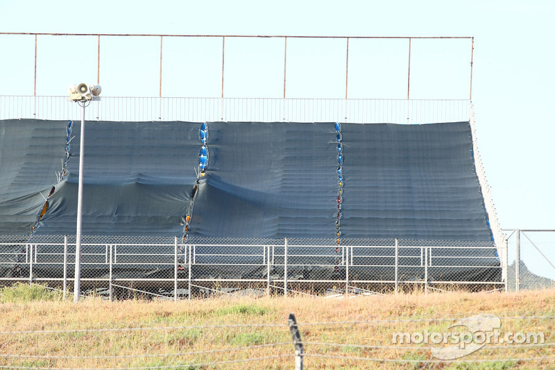 Empty Grand stands have been covered to hide them on TV, due to poor ticket sales