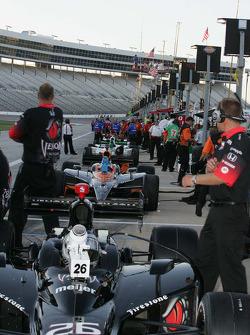 Cars sit on pit lane waiting on practice at Texas Motor Speedway