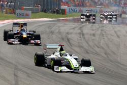Jenson Button, Brawn GP leads Sebastian Vettel, Red Bull Racing