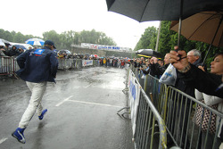 Sébastien Bourdais runs during a rain shower
