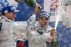 LMP1 podium: Stéphane Sarrazin and Marc Gene celebrate with champagne