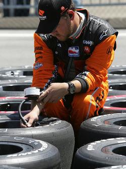 Andretti Green Racing team member prepares the tires