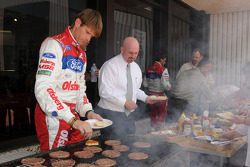 Ford Fiesta driver Marcus Gronholm takes a break from car prep and media duties for a Hamburger