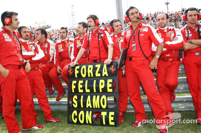 Scuderia Ferrari team members show their support for Felipe Massa