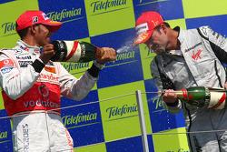 Podium: champagne celebration for race winner Rubens Barrichello, BrawnGP, second place Lewis Hamilton, McLaren Mercedes