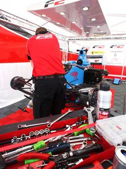 Mechanic works on the car of Armaan Ebrahim