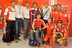 Del Torchio (2nd on the left), Preziosi (in front in the middle), Delbono (3rd on the left) with Bologna FC football players and Ducati Team