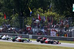 Lewis Hamilton, McLaren Mercedes leads Kimi Raikkonen, Scuderia Ferrari at the start of the race