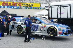 Hendrick Motorsports crew members do work to Dale Earnhardt Jr.'s trunk area after tech inspection