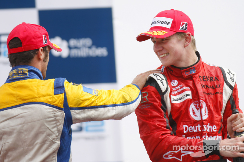 Nico Hulkenberg celebrates his victory on the podium with Luca Filippi