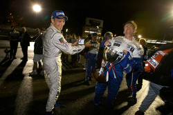 Race winner Stéphane Sarrazin gives a champagne shower to Bruno Famin