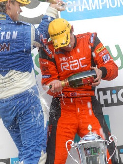 Tom Chilton pours champagne over Stephen Jelley