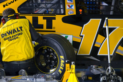 A crew member for Matt Kenseth works on his car