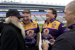 Dusty Hill drom ZZ Top jokes around with some of the crew members from the No. 26 Crown Royal crew