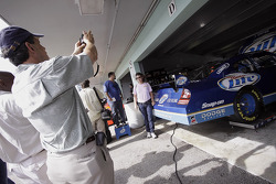 Fans take photos with Kurt Busch's number 2 Miller Lite Dodge in the garage